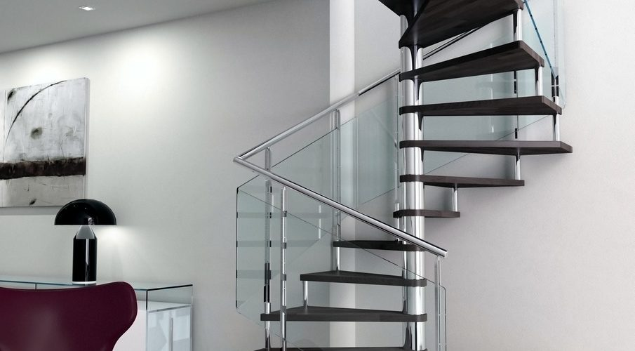 Stainless steel spiral staircase combined with wooden steps stainless steel newels and clear laminated glass.