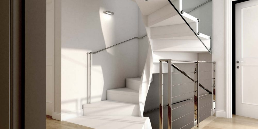 Square layout spiral staircase, closed risers, external glass railing combined with a touch of stainless steel.