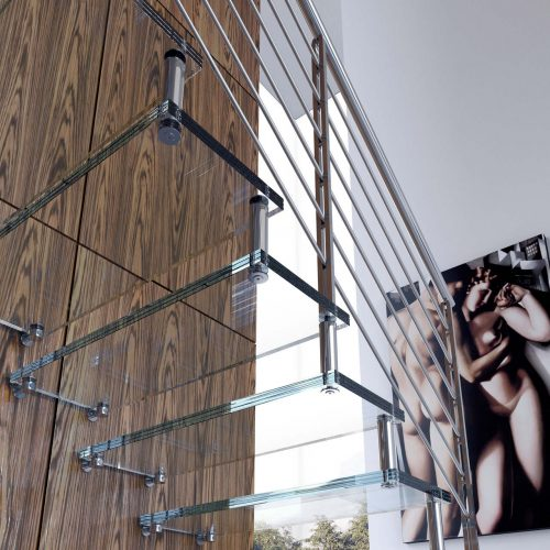 Glass staircase, glass steps, stainless steel polished railing.