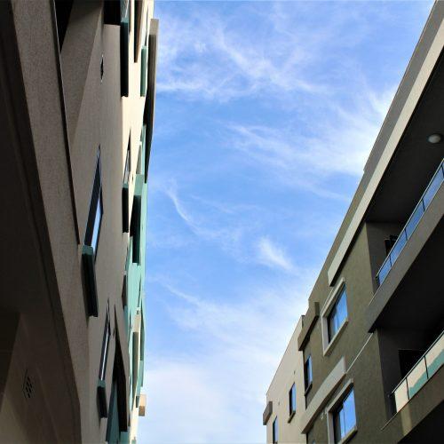 Glass balconies and aluminum windows and doors